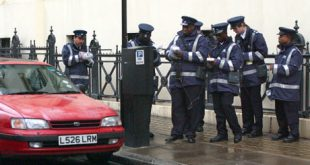 Traffic wardens issuing tickets
